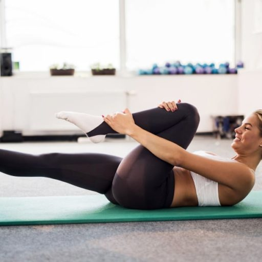 Lady Exercising with Pilates