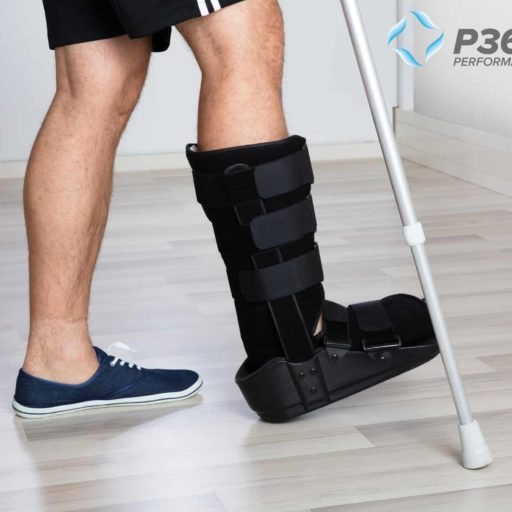 Man With Cam Boot From Stress Fractures