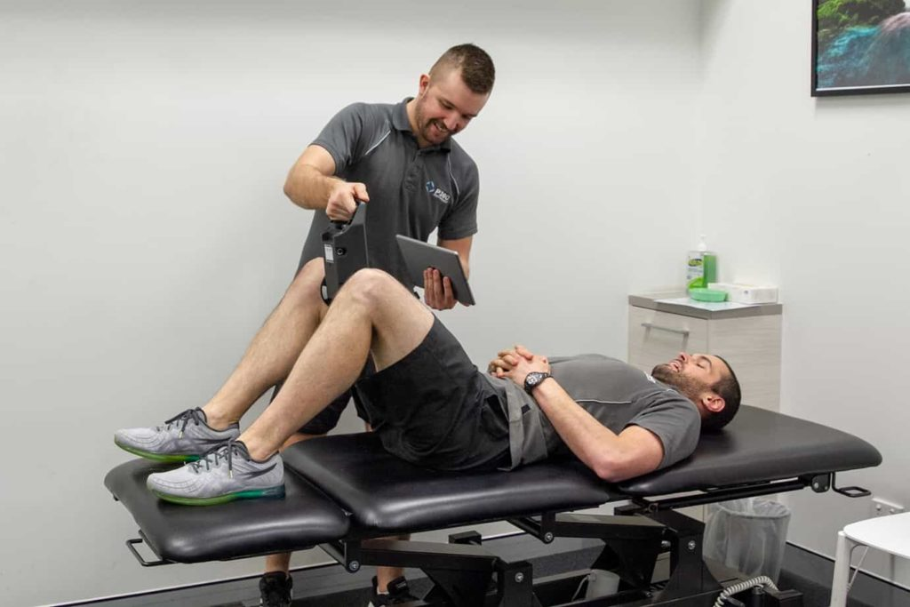 Exercise Physiologist performing assessment on patient